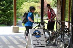 Mountain bikers gather outside of the bike shop at the Glyncorrwg Visitors Center. Tourism has become part of economic development plans.