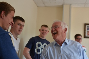 Retired miner Terry Thomas meets young apprentice miners at a newly opened mine in South Wales.