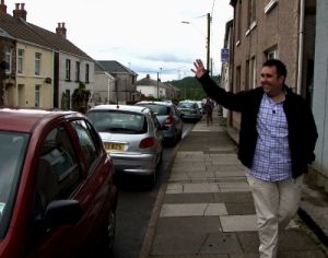 Dean Cawsey walks in his neighborhood of Banwen, Wales.