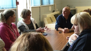 Mair Francis talks with community members at Croescrw Community Learning Centre in June, 2013.